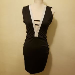 - Black Open Back Dress with Silver Detail